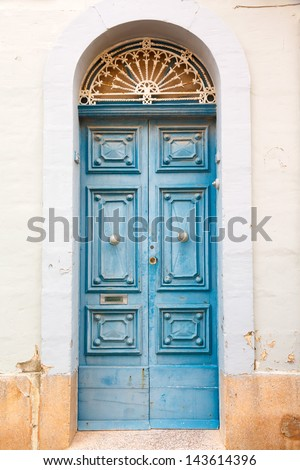 blue wooden front door to the house in the Mediterranean - stock photo