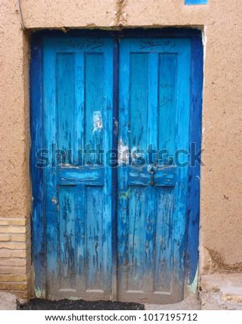 Blue wooden persian door against a cob wall & Blue Wooden Persian Door Against Cob Stock Photo (Royalty Free ...