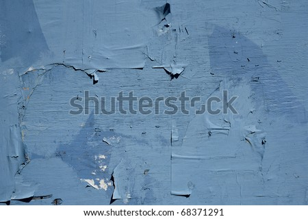 Blue wooden wall with pieces of paper - stock photo