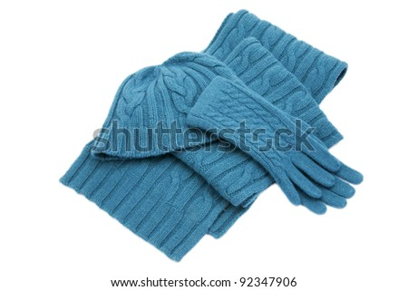 Blue wool knitted set isolated on white - stock photo