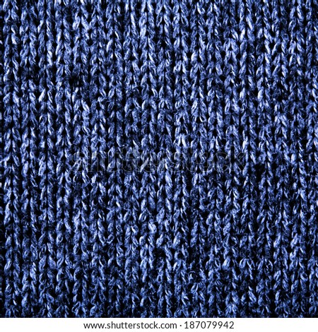 blue wool knitting pattern close up - stock photo
