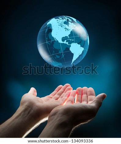 blue world in hands - stock photo