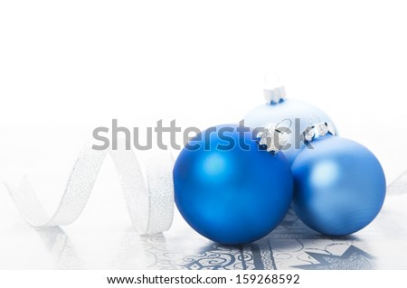 Blue xmas balls and silver ribbon on holiday background. Merry christmas! - stock photo