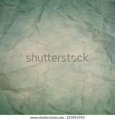 blue yellowish wrinkled paper texture or background - stock photo