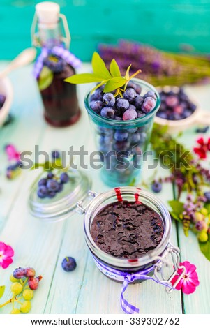 Blueberries, blueberries juice and jam with berries - stock photo