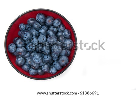 Blueberries in a red bowl, from above. - stock photo