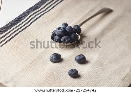 blueberries in a silver spoon - stock photo