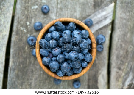 blueberries in a wooden bowl - stock photo