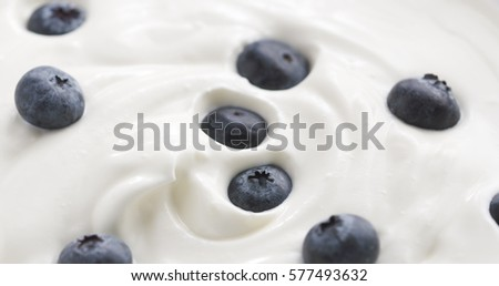 Blueberries in organic yogurt, 4k close up photo