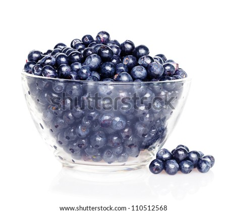 Blueberries in transparent glass dish with soft shadow on white background