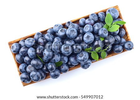 blueberries in wooden dish isolated on a white background