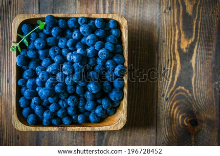 Blueberries on wooden background - stock photo