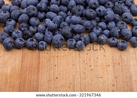 Blueberries on wooden texture background.