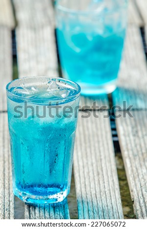 Blueberries punch in glass on wooden table - stock photo