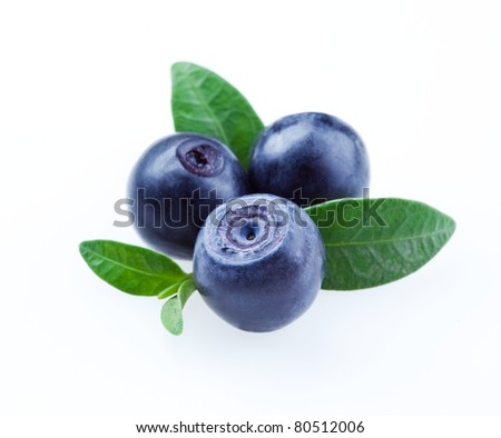 Blueberries with leaves isolated on white background - stock photo