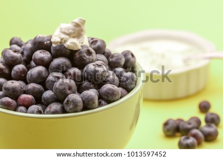 Blueberries with whipped cream.