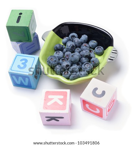 Blueberries with wooden blocks on white - stock photo