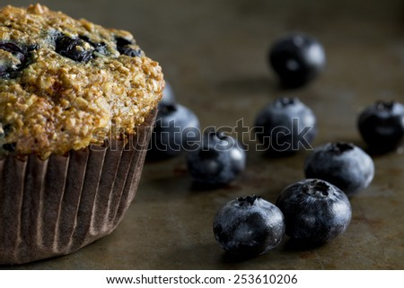 Blueberry Bran Muffin with Blueberries - stock photo