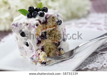 Blueberry cake with sour cream. Shallow DOF - stock photo