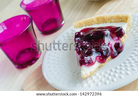 Blueberry cheese cake in white dish on the wood table