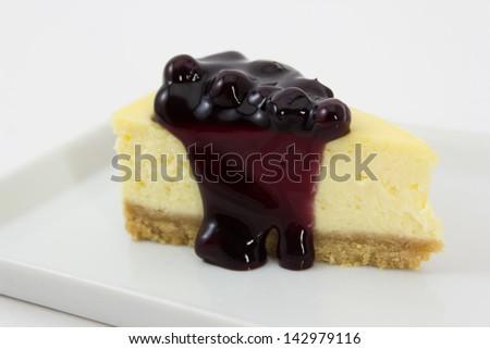 Blueberry cheesecake serve on white plate - stock photo