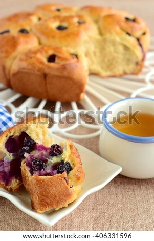 Blueberry cinnamon roll with cup of tea