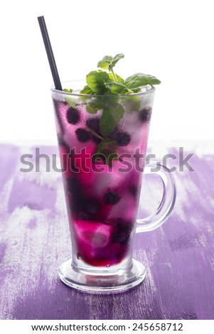 Blueberry cocktail with mint and lime - stock photo