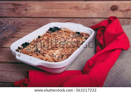 blueberry crumble with oatmeal and cinnamon on a wooden background - stock photo