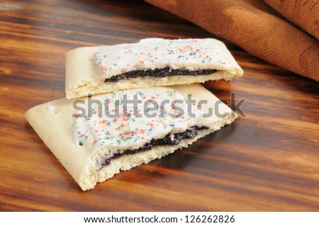 Blueberry filled toaster tarts with icing - stock photo