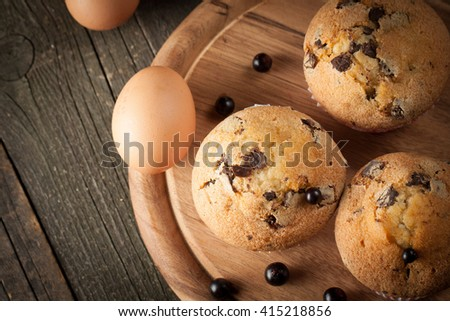 Blueberry home made muffins with cooking ingrdients, eggs, milk, flour and fresh berries. Healthy breakfast concept of baked cupcakes. - stock photo