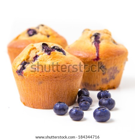 Blueberry muffins on white background - stock photo