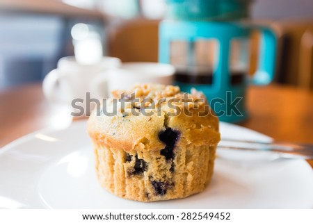 Blueberry muffins with coffee latte - stock photo