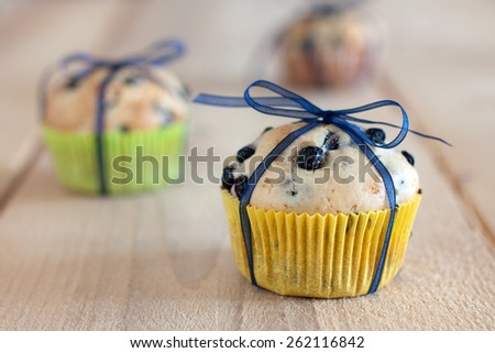 blueberry muffins with ribbon - stock photo