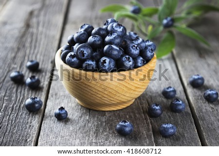 Blueberry on a dark wooden background