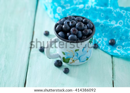 blueberry on wooden surface - stock photo