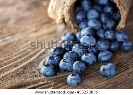 Blueberry on wooden table background - stock photo