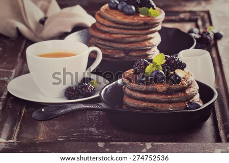 Blueberry pancakes with buckwheat flour for breakfast toned image - stock photo
