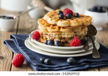 Blueberry waffles with raspberries for breakfast - stock photo