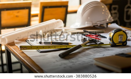 Blueprints, Hardhat, Glasses, Stickers, Construction level, Pen in architecture office retro style. - stock photo