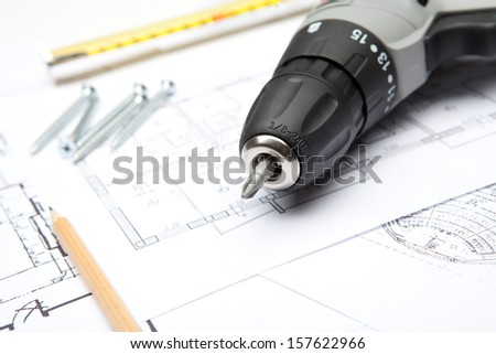 Blueprints with tools - stock photo