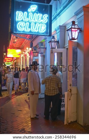 Blues club and neon lights on Bourbon Street in French Quarter of New Orleans, Louisiana - stock photo