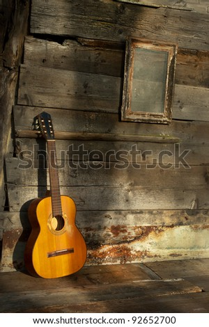 blues guitar the old wooden wall as background vertical - stock photo