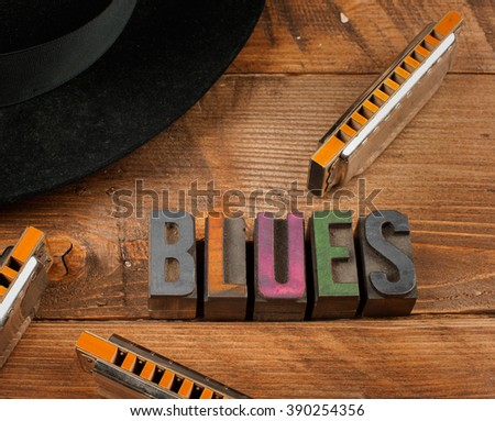 blues harps in wood background and word blues in letterpress type - stock photo
