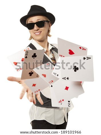 Bluff, happy woman in cap playing with poker cards - stock photo