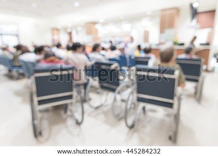Blur abstract background hospital medical healthcare center patient people on seats in waiting hall at cashier pharmacy counter front desk service: Blurry interior view clinic health care centre lobby - stock photo