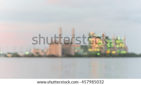 Blur abstract background of power plant at industrial park in San Antonio, US at twilight. The lake or reservoir in front provides cooling pond, recharged with treated wastewater for it.Panorama style - stock photo