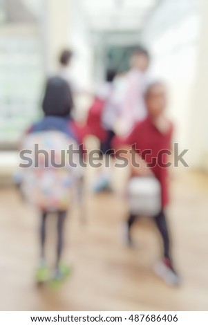Blur abstract background of primary and elementary students  going back to school. Blurry children walking outside classroom. Defocus schoolchildren walk inside building hall.
