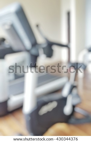 Blur abstract background of sports  fitness hall interior with fitness equipment in modern sports club.  Blurry view weight training equipment in sport room.