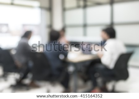 Blur abstract background office meeting business discussion colleagues people group: Educational presentation w/ projector slide screen in front of computer laptop, table: Blurry view inside interior - stock photo
