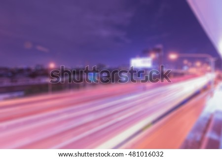 Blur abstract bokeh background in light on night street, blue and purple tone